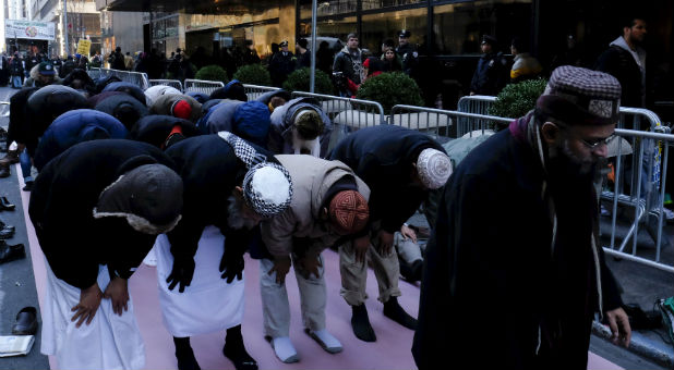 Muslims bow to pray in the UK.
