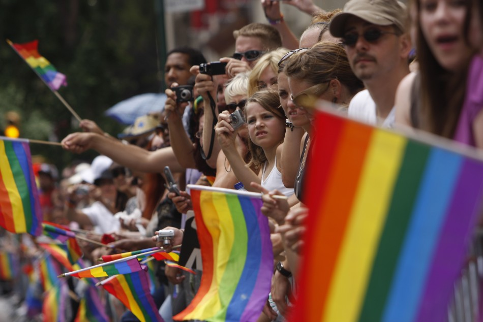 Spectators watch New York's Gay Pride Parade recently.