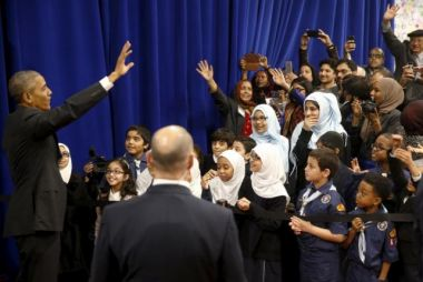 Barack Obama waves farewell to students afterspeaking at the Islamic Society of Baltimore mosque in Catonsville, Maryland in February.