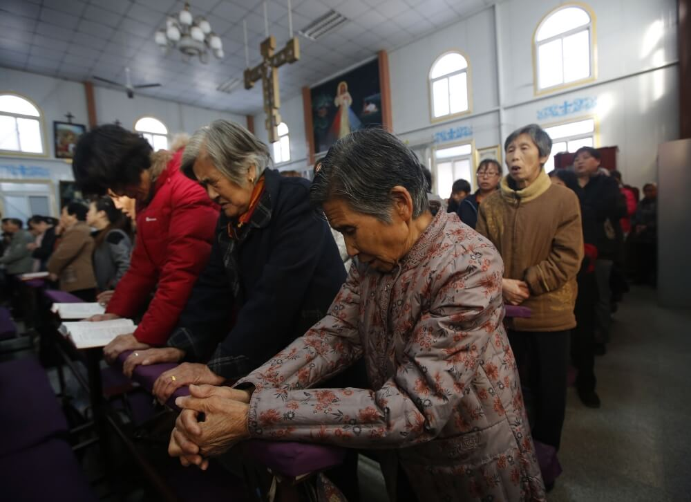 Believers take part in a weekend mass at a Catholic church in Tianjin, China, in 2013.