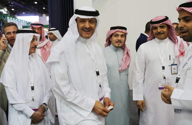 Prince Sultan bin Salman, center, talks to an official while he visits the Saudi Arabia stand at the ArabianTravel Market exhibition in Dubai, United Arab Emirates, on Tuesday.