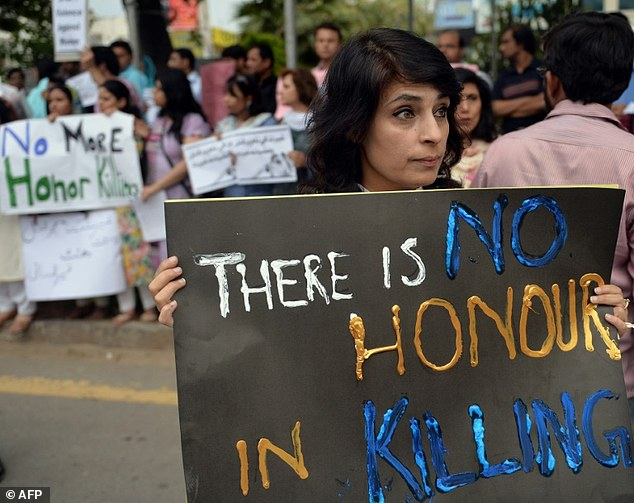 Human rights activists hold placards during a protest against honour killing in Islamabad in 2014.