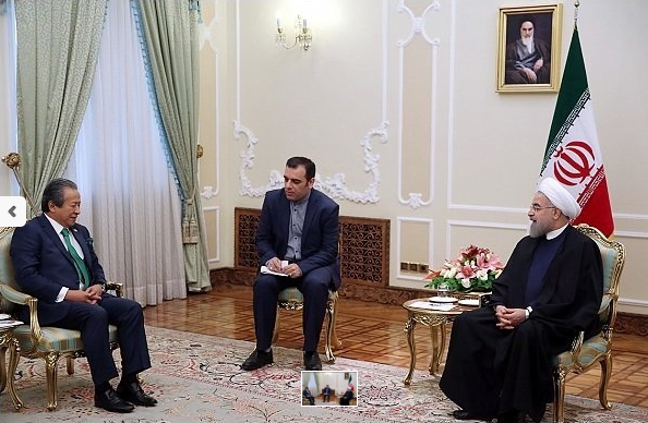 Malaysian Foreign Minister Anifah Aman, left, meets with Iranian President Hassan Rouhani, right.