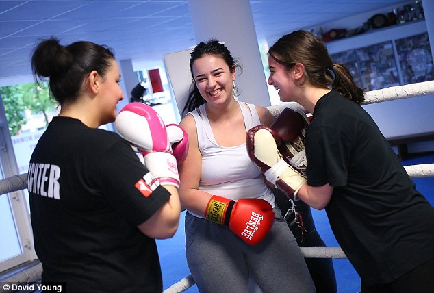 When Dilara Zajarskaite, center, took up boxing, it paid off.