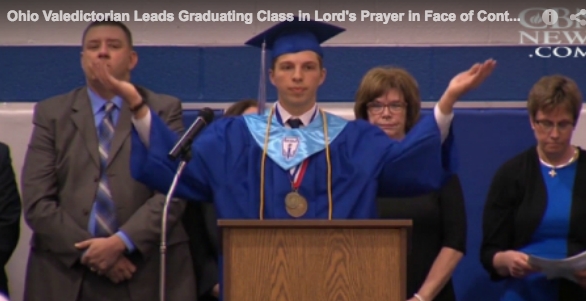 Jonathan Montgomery took the stage and led the class in reciting the Lord's Prayer.
