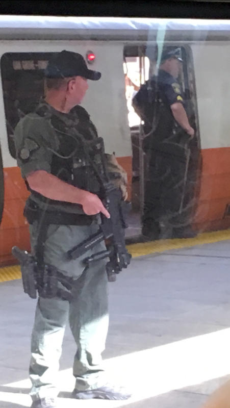 MBTA Police investigate a report of people acting suspiciously on the platform of the Orange Line stop at Wellington Station in Medford, Mass. recently.