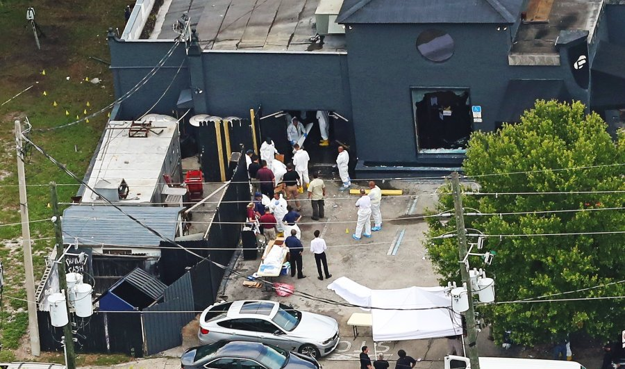 Forensic investigators work the scene of the Pulse nightclub shootings in Orlando in June.