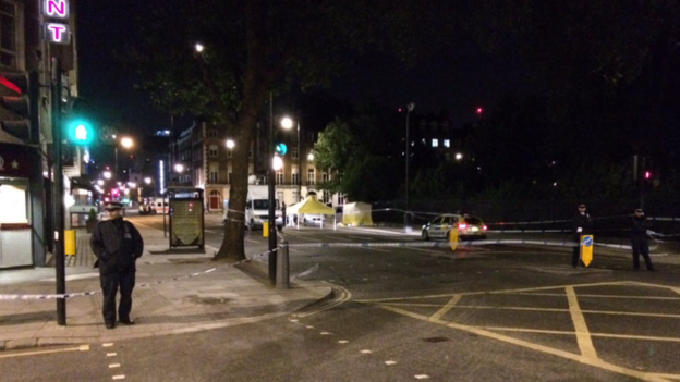 A forensics tent was put up next to the park in Russell Square, a busy part of central London.