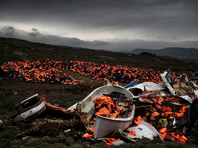 Boats and masses of lifejackets -- all bought and paid for by someone -- litter a Greek shore late last year.