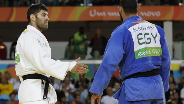 Egypt's Islam El Shehaby, right, backs away from Israeli Or Sasson after their Olympic bout.