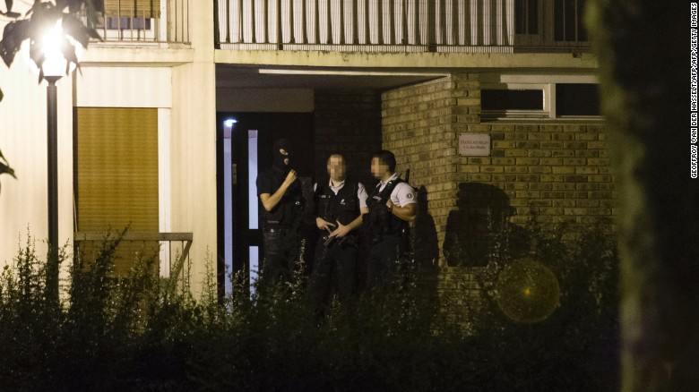 Police wait outside a building Thursday in Boussy-Saint-Antoine after the arrest of female suspects.