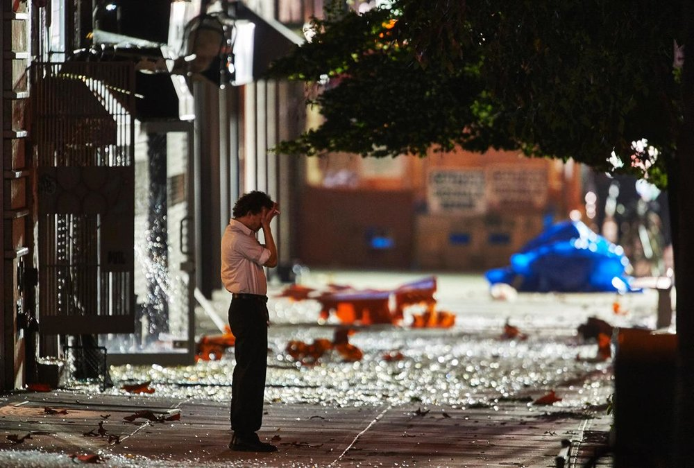 Debris litters 23rd St. and Sixth Ave. in Manhattan following a bomb blast on Sept. 18.
