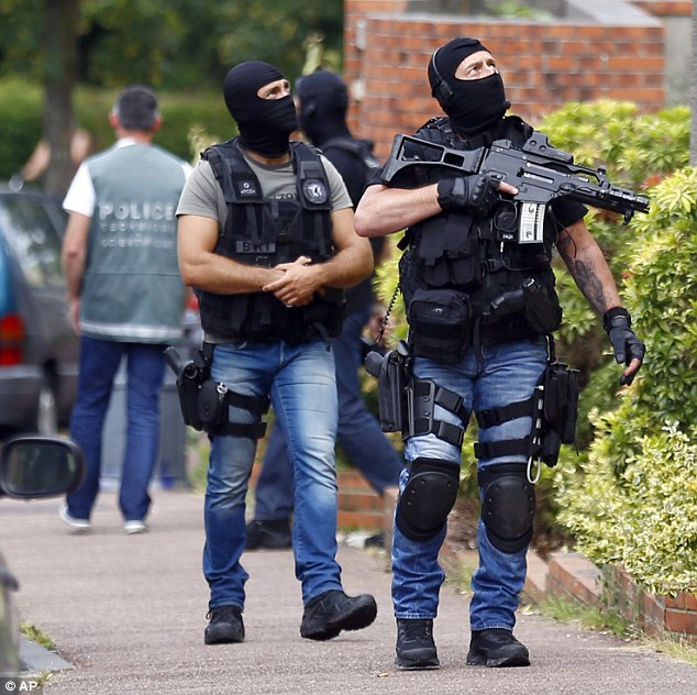 French Prime Minister Manuel Valls said that 'every day attacks are foiled ... (including) as we speak' (file picture of French anti-terror police)