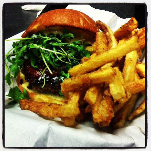 Twist Burger with our tasty twist fries!!! (Goat cheese, Carmelized onion, twist sauce,Arugula, Prosciutto & glaze with Balsamic syrup)