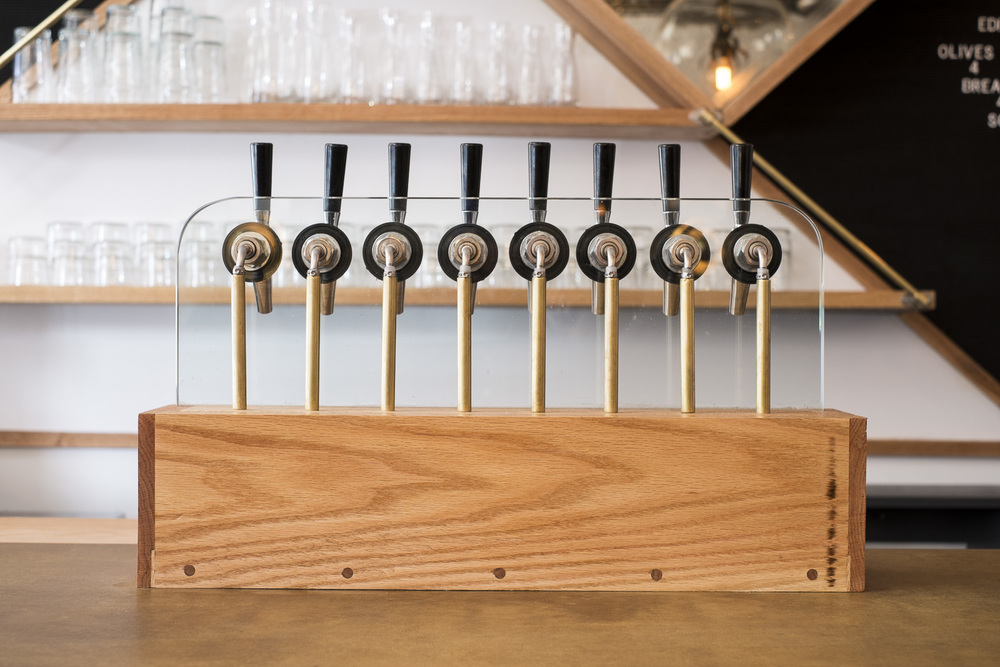 custom wine tap tower of white oak, brass, tempered glass