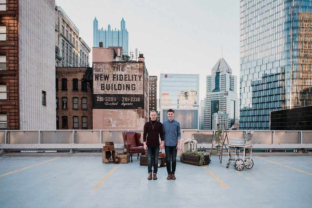 two males standing rooftop