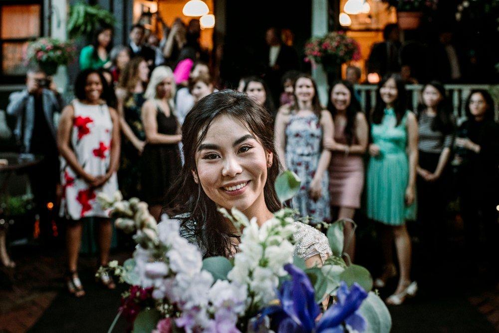 bride tossing bouquet