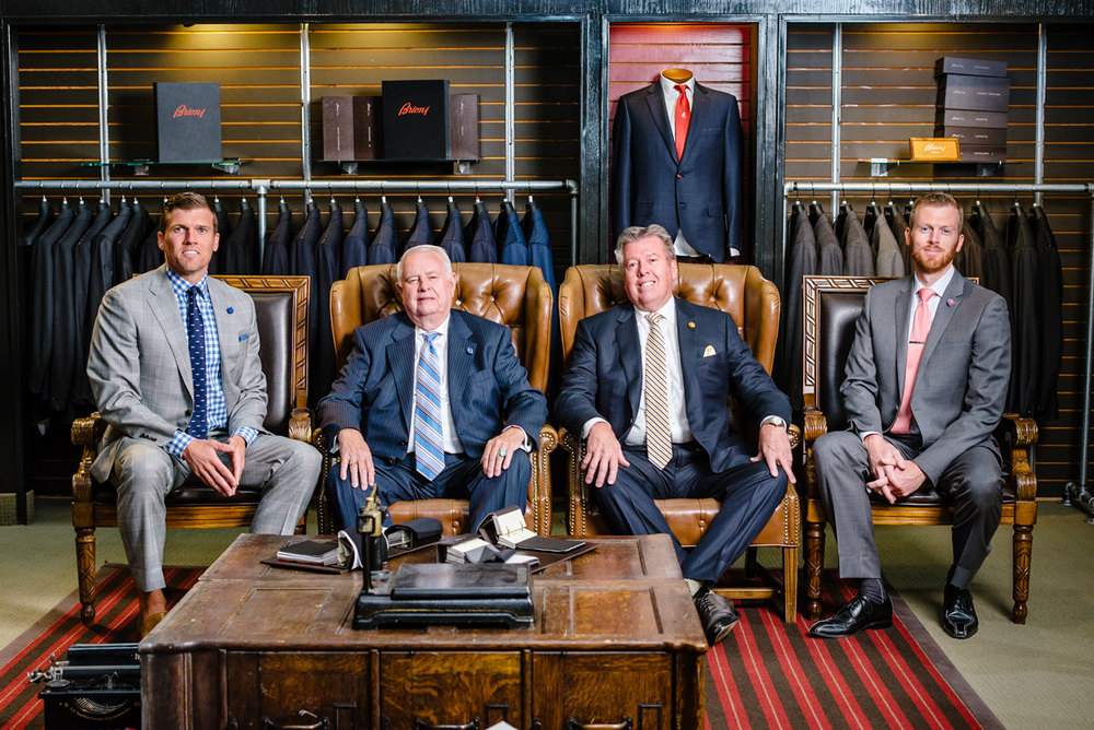 Four of the five generations of Stringham together in the Utah Woolen Mills store: B.J., Briant, Jr., Bart, and Brandon (left to right)