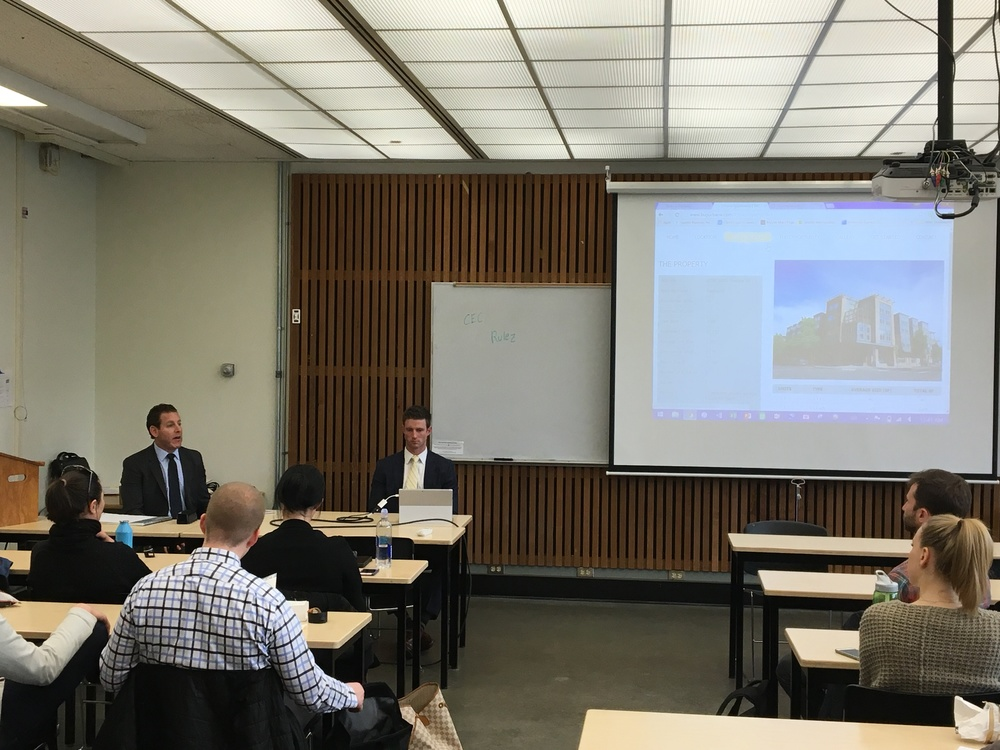 Dylan Simon and Jerrid Anderson of Colliers International speaking to Students