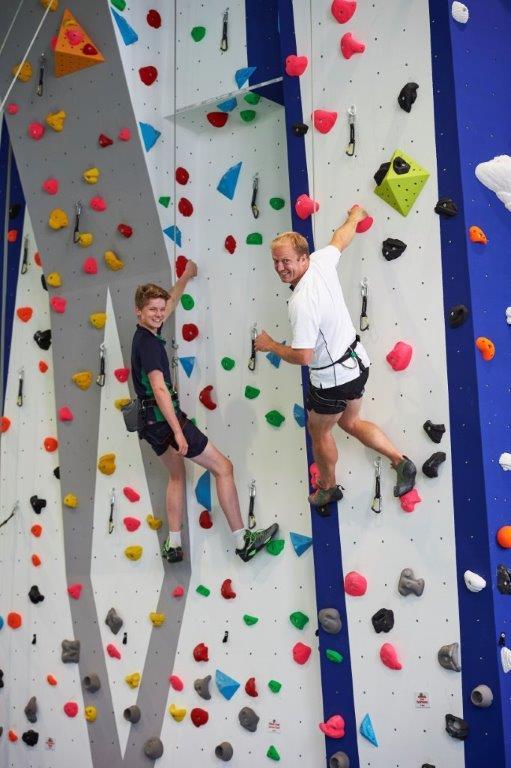 Headmaster and Head Boy, Tom Heley climb new wall.jpg