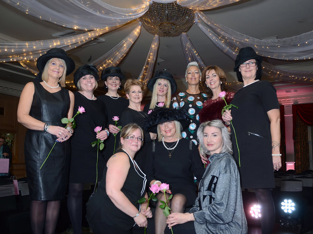 Melanie Hunnaball (seated) with staff at Hunnaball Family Funeral Directors, models and organisers of the show