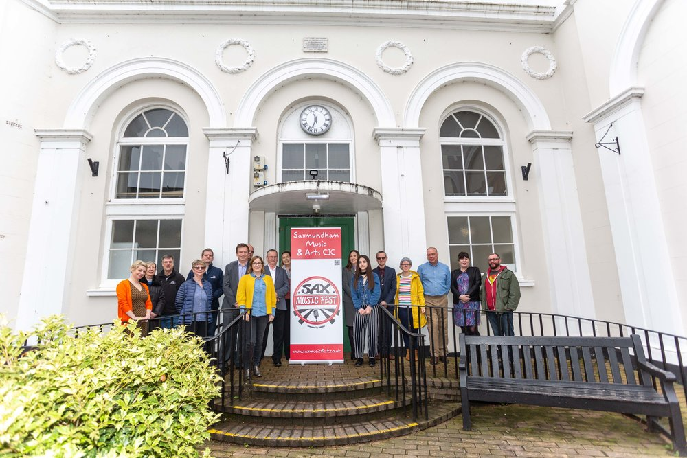 Sponsors and supporters of 2018 fest outside Saxmundham town hall.JPG