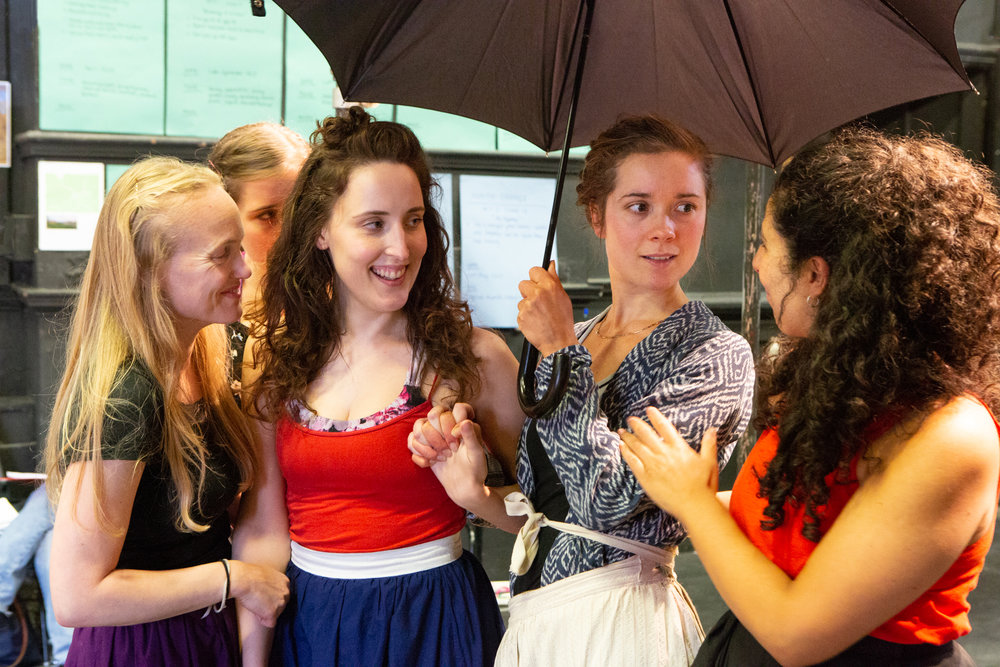 Cast under umbrella.jpg