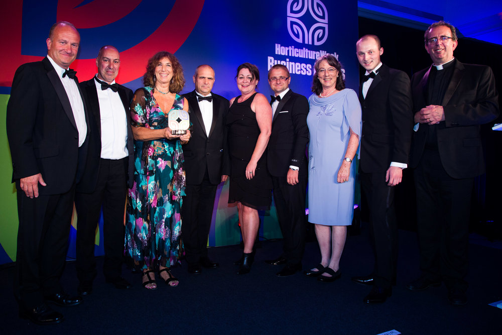 Family Directors and Senior Management Team from Boxford (Suffolk) Farms receive their award from host Richard Coles.jpg