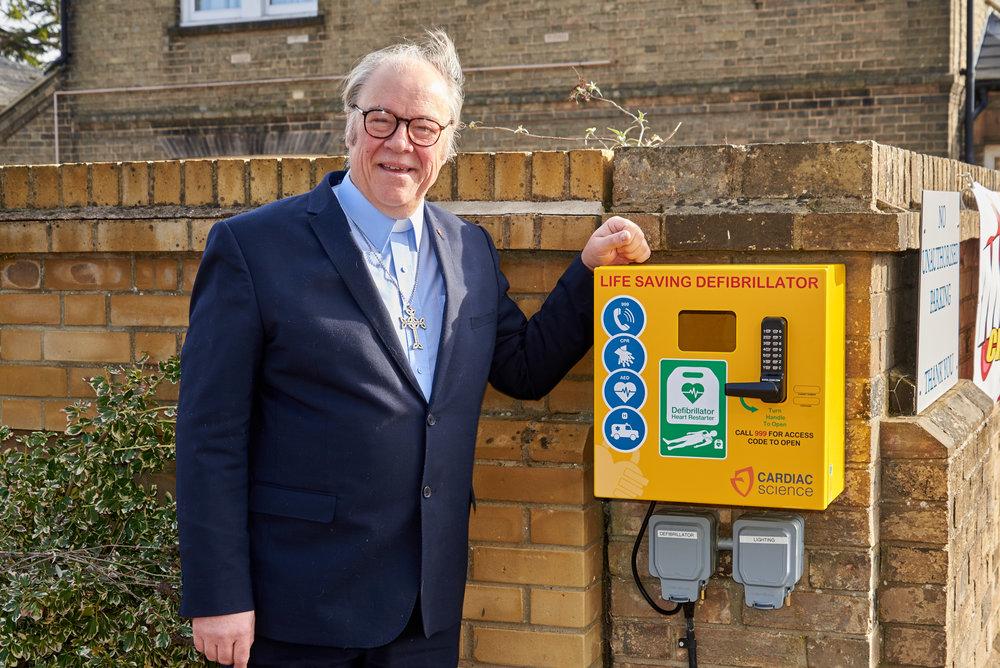 Rev Martin Dawes and the new Defibrillator at Woodbridge Methodist Church