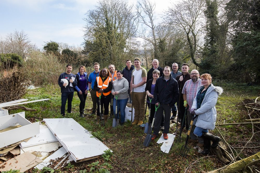 Volunteers from Hopkins Homes, including Josh Hopkins of the Hopkins Charitable Fund (front row, right hand side) and Managing Director Michael Cox (back row, centre right) with representatives from ACT, including Rob Fawcett (far left), and Andrea Pittock from the Suffolk Community Foundation (2nd from left)