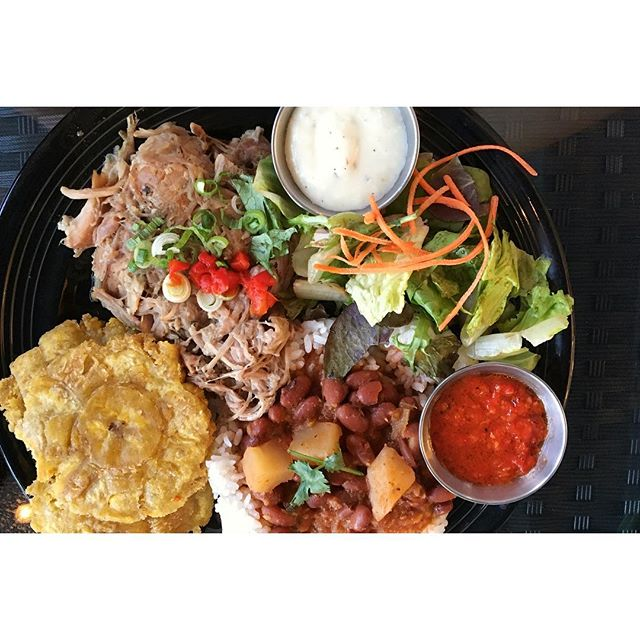 Pernil Divino: slow roasted, pulled pork shoulder with rice and beans, fried plantains, and a side salad 😋 . . #coasttoroastgoescoasttocoast #dawsonsontherun  City #seattle / Neighborhood #ballard