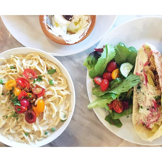 Ma'carona b'laban: spaghetti, yogurt, green peas, mint, garlic, butter, pine nuts, almonds, olive oil, and cherry tomatoes 🍅 Plus, delicious stuffed pita and salad 🥗  #coasttoroastgoescoasttocoast #dawsonsontherun  City #saltlakecity