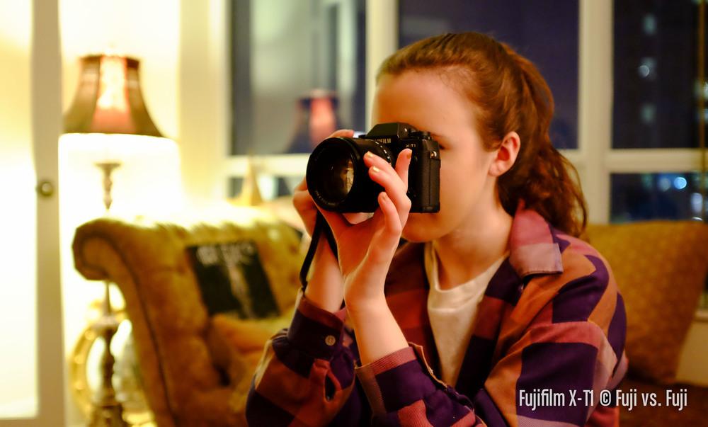 My niece, enjoying the X-T1,56mm f/1.2 combo