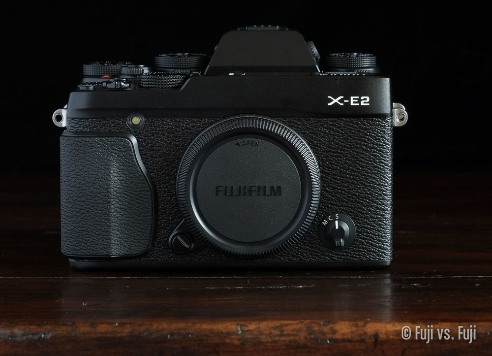 The Fujifilm X-E2 in front of the X-T1. The viewfinder hump is clearly visible over the X-E2. Perhaps this is a glimpse into the future  – Click to enlarge