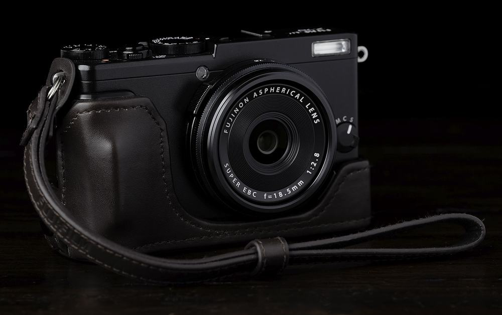 Fujifilm Fuji X70 with half case and strap.jpg