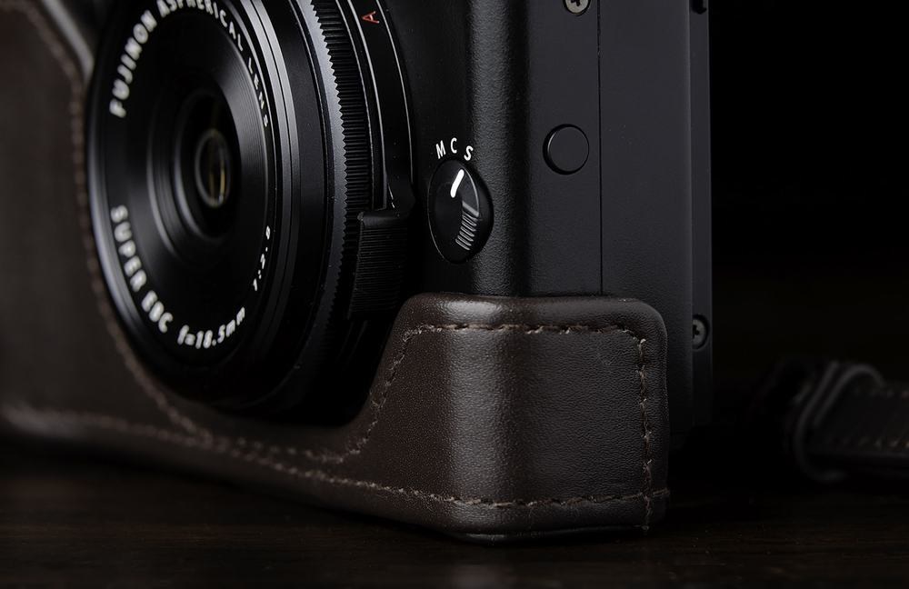 Depending on where your aperture is set, the half case might get in the way of the aperture ring grip