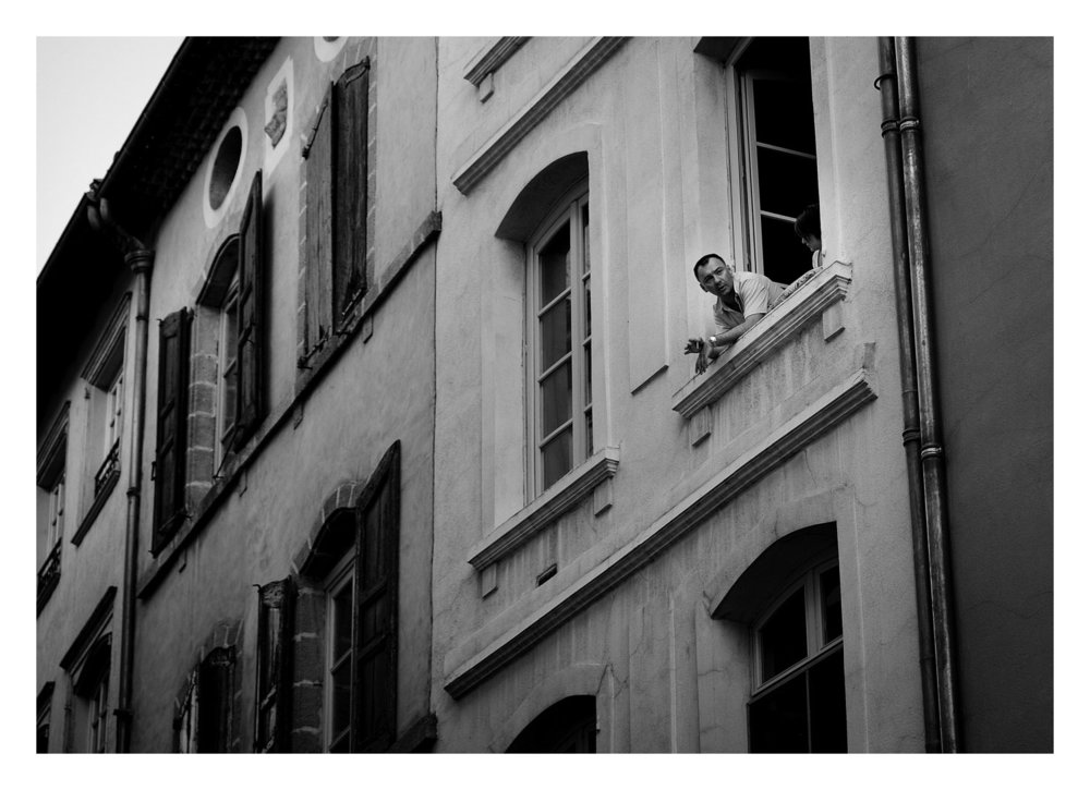 I was nuts about photographing people in windows and balconies on this trip