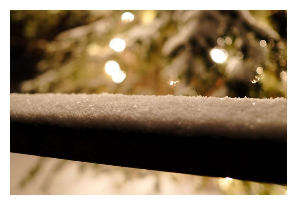 Considering how close the tree and lights were to this snow-covered railing, they're render rather nicely out of focus
