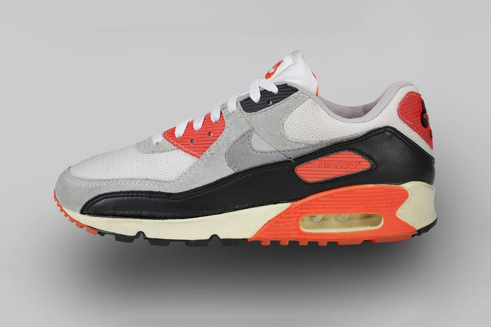 "AIR MAX 90 (1990) Once called ""Radiant Red,"" the now-iconic burstsof Infrared on this design would go onto define the AM90 and birth its own legend."