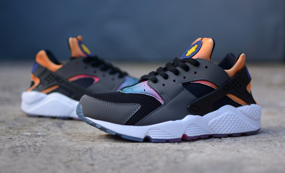 finest selection 177f4 ae274 ... Nike Air Huarache features a dark grey and anthracite upper offset by  an iridescent rainbow neoprene section on the tongue and collar.