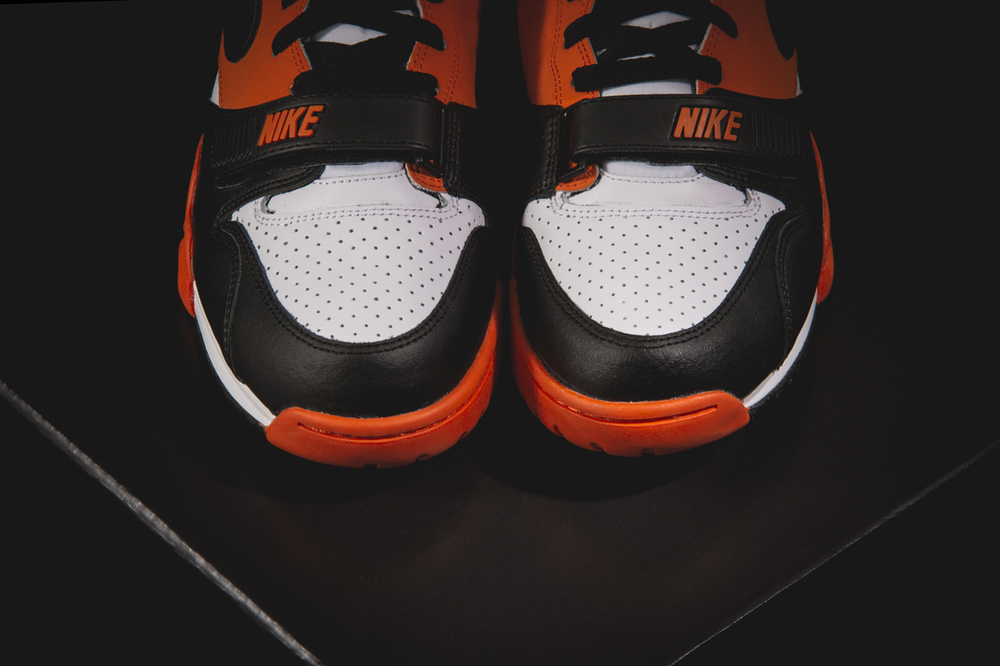 best website cd820 7b6c2 Nike branding is plastered on the heel, tongue, and toe strap, while the  Nike swoosh is halway there in solid black to help complete the sneaker.