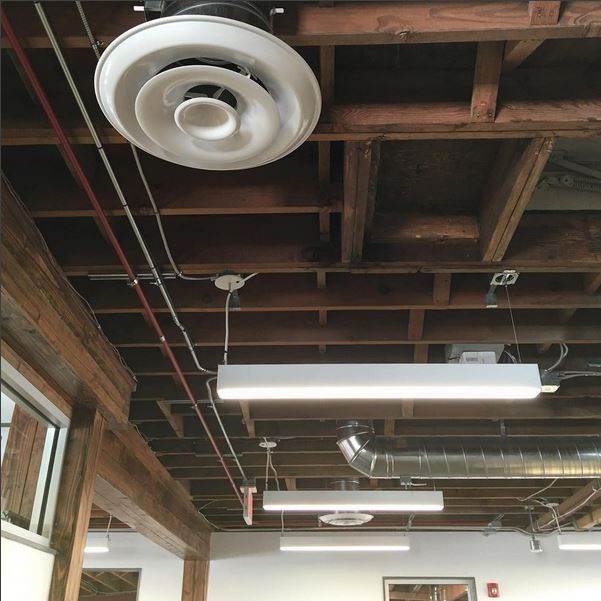 I spend a fair amount of time looking up...A ceiling shot from our just-completed Escondido high school counseling center.  #greatclients   #adaptivereuse   #exposedceiling   #ceiling   #kbarch   #kristibyersarchitect   #architecture   #lights   #oldbuildings   #design   #clerestory   #wood   #woodjoists   #conduit   #creativeoffice   #interiors