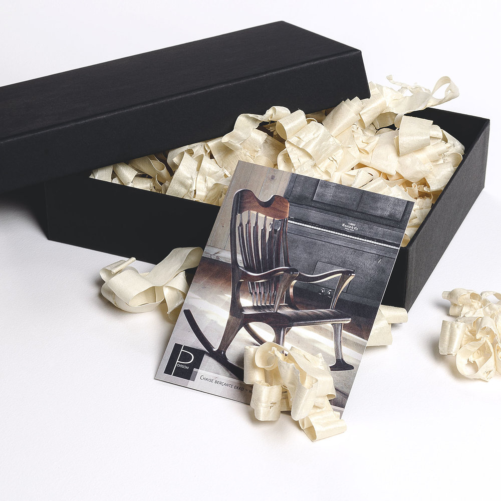 Gift box with a photo of the Ekko rocking chair.