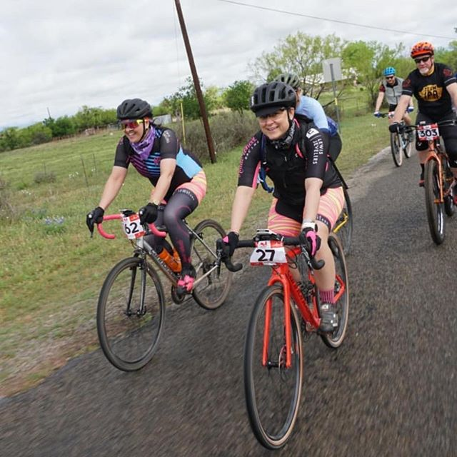 Two of our lovely leaders of Haute Wheels Racing smile despite storm delay and massive headwinds at the iconic Castell Grind. Love you and proud of you, Jessica and Kara!! 💖 #gravel #castellgrind #gravelgrinder #womenscycling #bikes