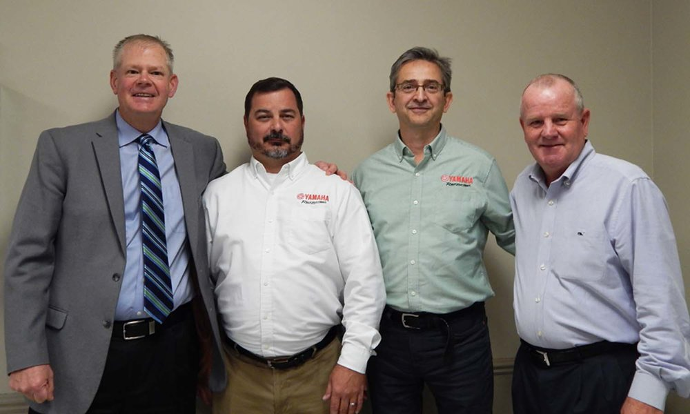 (pictured left to right) Jonathan Darling, President – Romo Durable Graphics, Michael Fincher, Purchasing Division Value Improvement Engineer – Yamaha Motor Company, Marek Goncerzewicz, Purchasing ASQ Engineering Manager – Yamaha Motor Company, Scott Hines, Sales Account Manager – Romo Durable Graphics