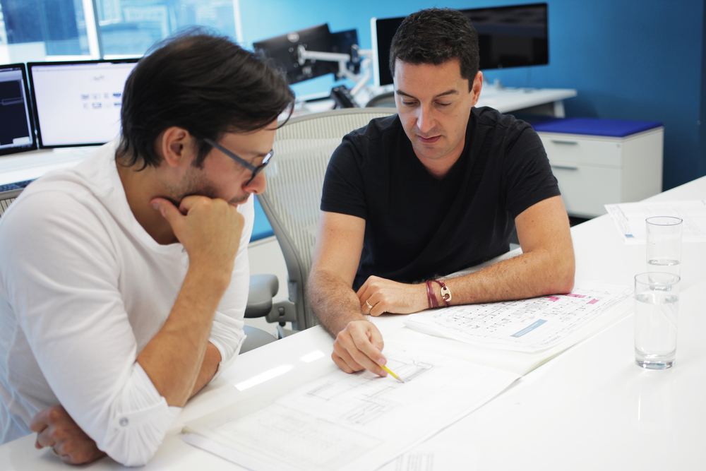 Julio and Mauricio discussing designs.