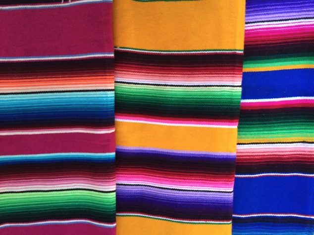 Mexican blankets. Pink, yellow, blue.