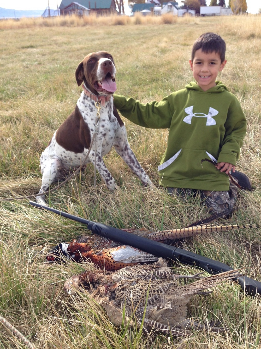 bullhead young boy with bird dog.jpg
