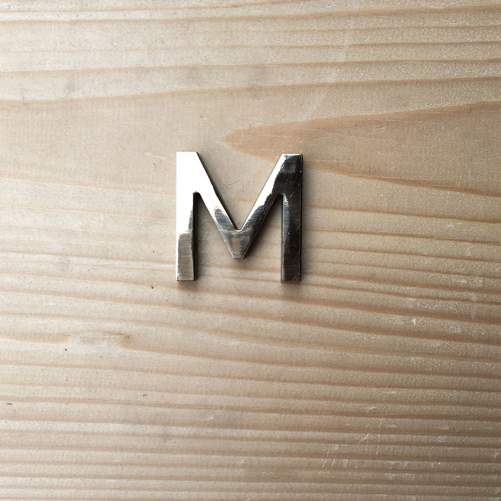M-polished-bronze-waterjetcut letter.jpg