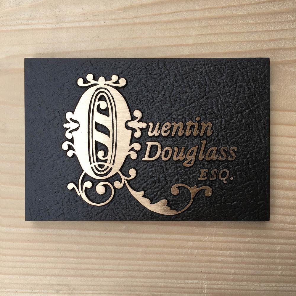 Quentin-bronze plaque-leatherette texture.jpg